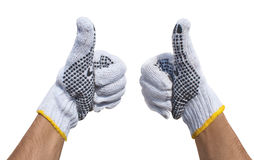 Hände in den Gewebehandschuhen, die o.k. getrennt darstellen Lizenzfreies Stockfoto