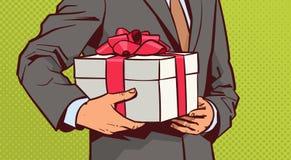 Hände des Geschäftsmann-Griff-Geschenks, Skizzen-Präsentkarton mit rotem Band-Bogen auf komischem Hintergrund stock abbildung