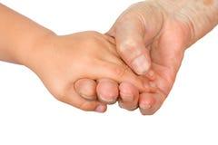 Hände des Mädchens und des gran Lizenzfreies Stockfoto