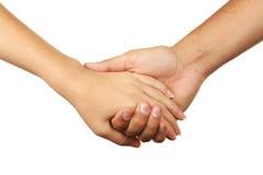 Hände des Mann- und Frauenzusammenhaltens Stockfotografie