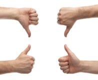Hände, die auf und ab Daumen zeigen Stockbilder