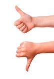 Hände, die auf und ab Daumen zeigen Stockfotografie