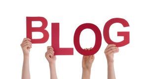 Hände, die Blog halten Stockfotos