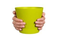 Hände, die Blumentopf halten Lizenzfreie Stockfotografie