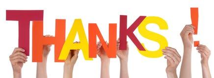 Hände, die bunten Dank halten Lizenzfreie Stockbilder