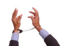 Hände, die Cuffed und oben erreicht worden sein würden Lizenzfreies Stockfoto