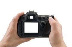 Hände, die Digitalkamera anhalten Lizenzfreies Stockbild