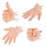 Hände, die durch Papier lochen stockfoto