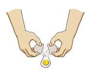 Hände, die ein Ei brechen lizenzfreie abbildung