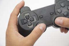 Hände, die ein gamepad halten Lizenzfreie Stockbilder