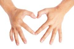 Hände, die ein Herz auf weißem Hintergrund bilden Stockbild