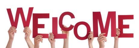 Hände, die ein rotes Willkommen halten stockbilder
