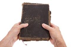 Hände, die eine Bibel anhalten Stockbilder