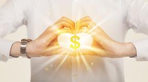 Hände, die eine Form mit Dollarzeichen schaffen Lizenzfreie Stockbilder
