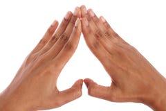 Hände, die eine Innerform bilden Stockfotos