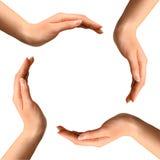 Hände, die einen Kreis bilden Stockbild