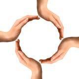 Hände, die einen Kreis bilden Stockfoto