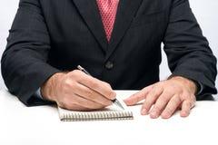 Hände, die einen Stift anhalten Stockfotos