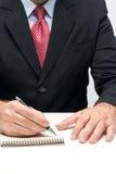 Hände, die einen Stift anhalten Lizenzfreie Stockfotos