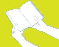 Hände, die geöffnetes Buch anhalten Lizenzfreies Stockfoto