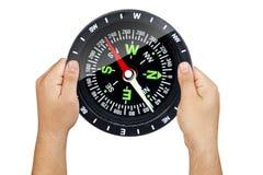 Hände, die Kompass halten lizenzfreie stockfotos