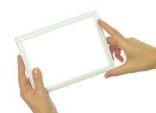 Hände, die leeren Fotorahmen halten Stockfotos