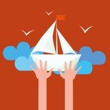 Hände, die Segelboot halten Stockbilder