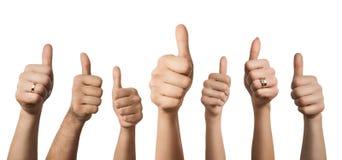 Hände, die sich Daumen zeigen Lizenzfreie Stockfotos