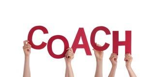 Hände, die Trainer halten lizenzfreies stockbild