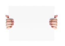 Hände, die unbelegte bekanntmachende Karte anhalten Lizenzfreies Stockfoto
