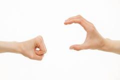 Hände, die verschiedene Größen - von kleinem zu großem zeigen Lizenzfreies Stockbild