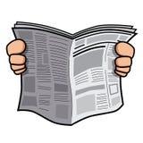 Hände, die Zeitung halten Stockfoto