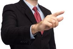 Hände in einem Anzug, der die Note gibt Stockfoto