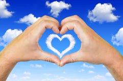 Hände in Form von Herzen Stockbild