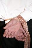 Hände gebunden auf dem Abkommen Lizenzfreies Stockbild