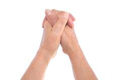 Hände gekreuzt Stockfoto