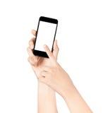 Hände halten und Punkt an einem Großleinwand-intelligenten Telefon auf Weiß Stockfotografie