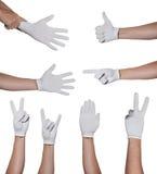 Hände im Handschuh, der die simbols lokalisiert auf Weiß macht Stockbilder