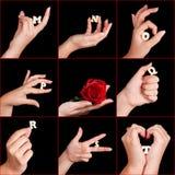 Hände mit Alphabetzeichen Stockfotografie