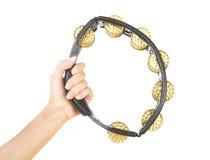 Hände mit einem Tamburin (Hände spielen das Tamburin) Lizenzfreie Stockfotografie