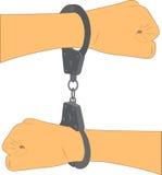 Hände mit Handschellen gefesselt mit verschiedenen Seiten Lizenzfreie Stockfotografie