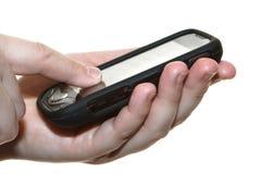 Hände mit Handy Lizenzfreies Stockbild