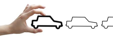 Hände mit Konzeptschwarzautos Stockfotografie