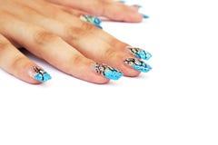Hände mit Nagelkunst Lizenzfreie Stockbilder