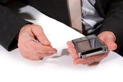 Hände mit Taschen-PC Stockfoto