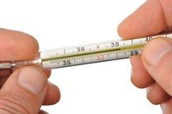 Hände mit Thermometer lizenzfreies stockfoto