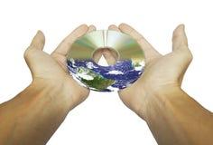 Hände und CD oder DVD Stockbild