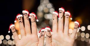 Hände und Finger in Sankt-Hüten am Weihnachten Lizenzfreie Stockfotografie