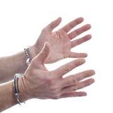 Hände und Handschellen Lizenzfreie Stockbilder