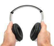 Hände und Kopfhörer Lizenzfreie Stockfotografie
